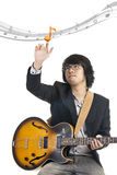 Asian young musician playing guitar Royalty Free Stock Photos