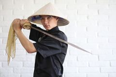 Asian young novice on a white brick wall stock image
