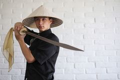Asian young novice on a white brick wall stock photography