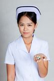 Asian young nurse with pills on her palm hand Royalty Free Stock Images