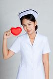 Asian young nurse show red heart Royalty Free Stock Photos