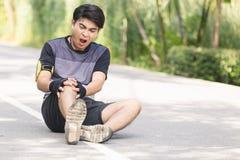 Sport man knee injury stock photography