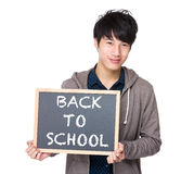 Asian young student with blackboard showing back to school. Isolated on white Royalty Free Stock Image