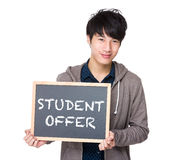 Asian young student with blackboard showing the phrases of stude. Nt offer isolated on white background Stock Photography