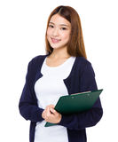 Asian young student holding with the clipboard Stock Photo