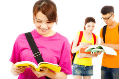 Asian young student read a  book  with classmates. Over white background Royalty Free Stock Images