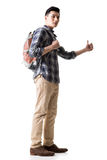 Asian young traveling man hitchhiking Royalty Free Stock Image