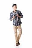 Asian young traveling man walking Stock Photos