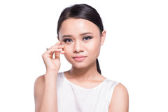 Asian young woman beauty shot isolated on grey background. Royalty Free Stock Image