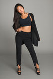 Asian young woman in black trousers. Stylish asian young woman in black trousers royalty free stock image