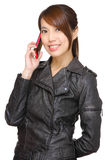Asian young woman calling by phone Royalty Free Stock Image