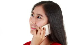 Asian young woman calling to discuss. By mobile phone; beautiful teenage on white background Royalty Free Stock Photo