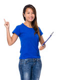 Asian young woman with clipboard and finger point up Stock Photography