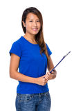 Asian young woman with clipboard Royalty Free Stock Photo