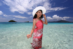 Asian young woman enjoy the sun. Young beautiful woman enjoying the sun on the beach Royalty Free Stock Images