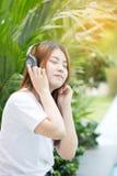 Asian young woman enjoying with her music Stock Photos