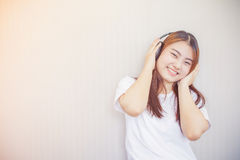 Asian young woman enjoying with her music Stock Image