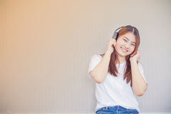 Asian young woman enjoying with her music Stock Photo