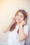 Asian young woman enjoying with her music Royalty Free Stock Images