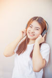 Asian young woman enjoying with her music listening Royalty Free Stock Image