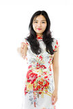 Asian young woman giving hand for handshake isolated on white background Royalty Free Stock Photo