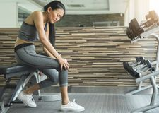 Asian young woman having knee pain. From workout royalty free stock images