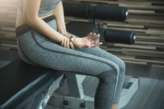 Asian young woman having wrist pain. Or injury from workout royalty free stock images
