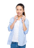 Asian young woman with headphone on shoulder Royalty Free Stock Photography
