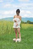 Asian young woman with her dog. The asian young woman with her dog Stock Images