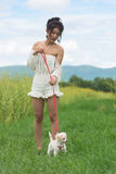 Asian young woman with her dog. The asian young woman with her dog Stock Photo