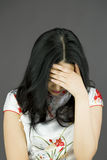 Asian young woman hiding her face Stock Images