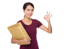 Asian young woman hodling with folder and ok sign gesture Royalty Free Stock Photography