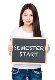 Asian young woman hold with chalkboard showing phrase of semeste Royalty Free Stock Photography