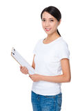 Asian young woman hold with clipboard Royalty Free Stock Image