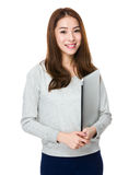 Asian Young woman hold with notebook computer Royalty Free Stock Photo