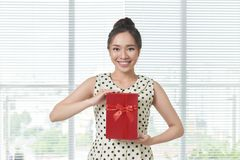 Asian Young Woman hold with present box stock images