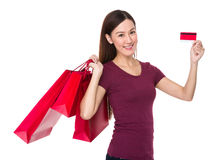 Asian young woman hold with shopping bag and credit card Royalty Free Stock Photos