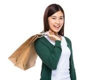 Asian young woman hold shopping bag Royalty Free Stock Photos