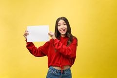 Asian young woman holding blank board or paper stock photos