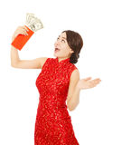 Asian young woman holding a red envelope of dollar Stock Photo
