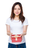 Asian young woman holding a red gift box Royalty Free Stock Photography