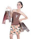 Asian young woman holding shopping bags Royalty Free Stock Images