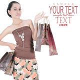 Asian young woman holding shopping bags Royalty Free Stock Photography