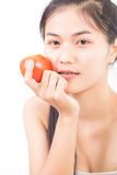 Asian young woman holding tomato Stock Photography