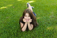 Asian young woman lie on grass Royalty Free Stock Photo