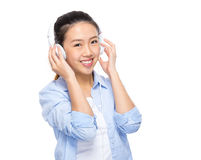Asian young woman listen headphone Stock Image