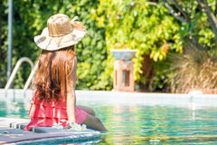 Asian young woman Living. By the pool in the summer in the morning Royalty Free Stock Photography
