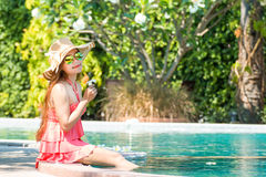 Asian young woman Living. By the pool in the summer in the morning Royalty Free Stock Images