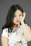 Asian young woman looking bored Royalty Free Stock Image