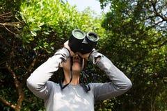 Asian Young woman looking though binocular Stock Image